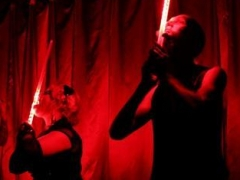 Andrew S. & Kelvikta Swallowing LED light swords