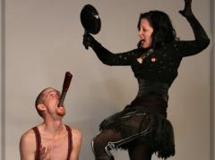 Andrew S. & Kelvikta hammering in swords with a frying pan!